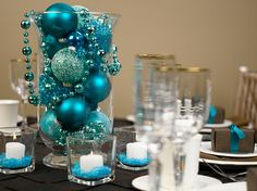 Simplistic use of items to create centerpieces.   Event Decor- Winter Wonderland Style