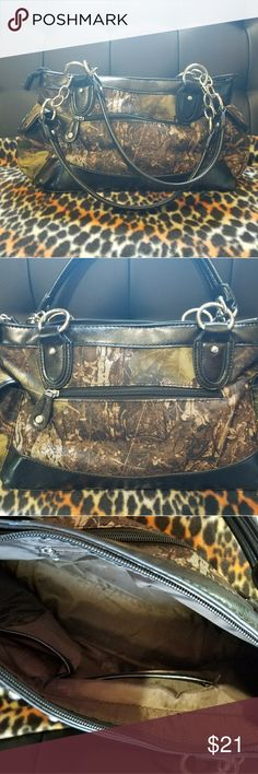 """EUC Camo Purse. Silver Hardware. EUC Camo Purse. Silver Studs, Chain Straps. Pockets on both ends. Front and back zippered pockets.  Measurements: Length 17"""" Width 4 1/2 Tall 9"""" Straps 11"""" Bags"""