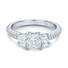 Custom Three Stone and Pave Diamond Engagement Ring Platinum Ring 2 Diamonds - .41 ctw 78 Diamonds - .35 ctw Clarity: VS2 - Color: F-G