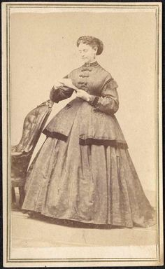 "CDV portrait of a well-dressed woman reading a letter. Written on verso of mount in ink in a period hand is; ""Lizzie Hammond / 1866"". Backmark of ""Robinson Bros., Haverhill, MA""."