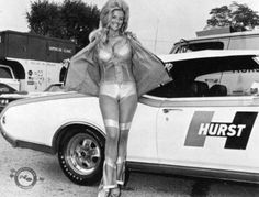 Linda Vaughn poses with a Hurst Olds