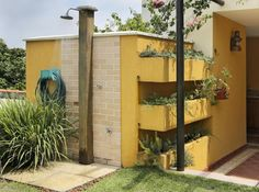 Camille Kurowsky's Green Roof House has lovely gardens on the walls.