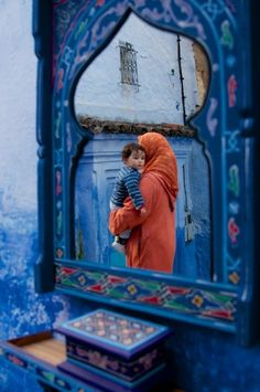 Woman and Child Reflected in Mirror by Ralph Velasco Chefchaouen, Morocco. Moroccan Blue, Moroccan Style, We Are The World, People Of The World, Blue City, Thinking Day, North Africa, Mother And Child, Incredible India
