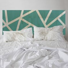 A wander through the emerald forest. Be inspired by the thoughtfully designed MUSE headboard. Strips of natural wood are revealed between the coloured sections. This bedhead is made up of a series of individual hand-painted tiles that feature removable adhesive square patches on the back for easy install. Carry through the emerald from the headboard using cushions, throws and linens for a cohesive look.Enjoy this artistic addition to your bedroom and nod-off in style.