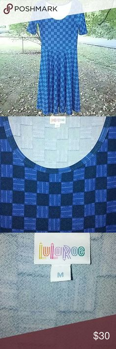 Lularoe Nicole black and blue plaid dress Stunning black and blue Lularoe dress.  Nwot. LuLaRoe Dresses