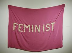 Megan Savoy's hand sewn FEMINIST flag for her thesis (held up by earrings).  pdx, oregon <3