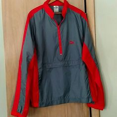 Puma Nylon Pull Over In excellent condition!! Has a hood that can be zipped up into the collar. A front zippered pocket. Puma Jackets & Coats