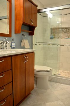 Bertch Legacy Bath Cabinetry. Door and drawer style: Toronto. Alder wood, toffee stain, brown glaze.