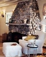 A heartwarming hobbit fireplace plus your favorite chair equals a perfect place to curl up with a book by J. River Rock Fireplaces, Outdoor Stone Fireplaces, Stone Fireplace Designs, Stone Mantel, Stone Slab, Brick And Stone, Stone Chimney, Fireplace Pictures, Cottage Fireplace