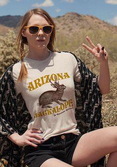Keep your eyes peeled for the legendary Jackalope--Arizona's most fearsome critter. The Jackalope Tee / womens graphic tees / vintage style southwest t shirt / phoenix arizona jackrabbit gifts souvenir t-shirt Phoenix Arizona, Casual Outfits, Cute Outfits, Girl Outfits, Look Retro, Graphic Shirts, Tee Shirts, Vintage Tees, Street Style Women