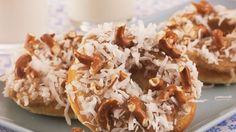 Baked cake-like Bisquick® mix doughnuts glazed with thick caramel sauce and topped with broken pretzel twists and flaked coconut – perfect for your sweet-salty cravings.