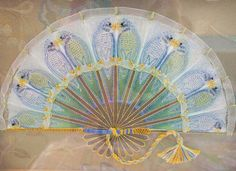 "This is just all kinds of exquisite - ""Budgie Fan"" from the talented embroiderer Gary Clarke. Stitched in silk on a base of stretched organza, embellished with beads and organza ribbon. This piece is available as a kit from Gary's website at http://www.garyclarkedesigns.com/products.php?category=Organza"
