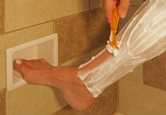 Bathroom Remodeling Design Ideas Tile Shower Niches: Shower Shaving Foot Rests