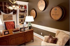 The study was painted a dark gray.  The rug is from Stark with Festoni lamps and Ralph Lauren fabrics.   The desk chair is custom.   Wine barrels from Joyce Horn.  I think the barrels are such a cute idea, especially in a man's study.