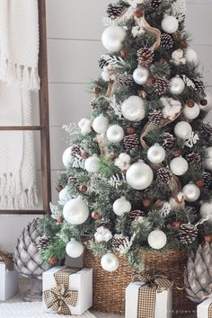 Burlap ribbon from top to bottom, large white balls. pine cones, rusty metal bells, and little pieces of cotton wood. christmas tree with ribbon Simple Farmhouse Christmas Bedroom - Love Grows Wild Best Christmas Tree Decorations, White Christmas Trees, Christmas Tree Design, Beautiful Christmas Trees, Christmas Holidays, Christmas Lights, Christmas Themes, Silver Christmas, Outdoor Christmas