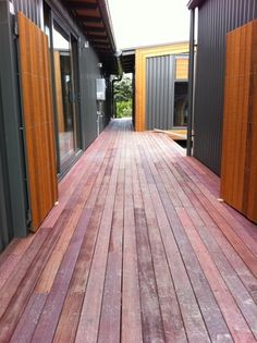Another view of the exterior with its bold forms, finished in shiplap cedar in Resene Wood X Kauri Gum, supplied by Herman Pacific. Aluminium Joinery, House Cladding, Roof Extension, Cedar Homes, Little Cabin, Indoor Outdoor, Outdoor Decor, Breezeway, Flat Roof