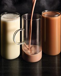 Hot Cocoa Three Ways - Dark-Chocolate Hot Cocoa, White-Chocolate Hot Cocoa w/ Coconut and Rum, or Milk Chocolate and Peanut Butter Hot Cocoa.