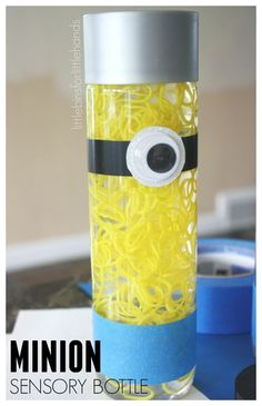 Minion Sensory Bottle With Loom Bands. Easy to make Minion sensory bottle engaging the sense of sight for kids. Fun and simple Minion activity.
