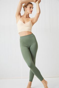 0c51665e Model front image of Arket seamless™ yoga tights in green Tights,  Stickning, Yoga