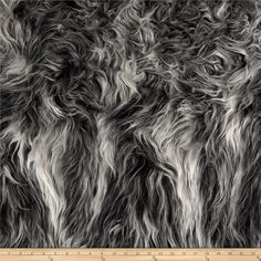 Faux Fur Artic Mongolian Fur Ivory/Grey from @fabricdotcom  This soft high quality faux fur fabric has a 3'' long pile. It's perfect for stuffed animals, faux fur jackets and vests, pillows and throws.