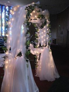 Here is a metal arch-- decorated with flowers and tulle