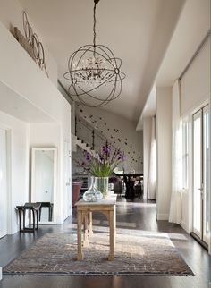 Iron orb chandelier cottage entrancefoyer vallone design entry foyer orb crystal chandelier console rug ashleycampbell aloadofball