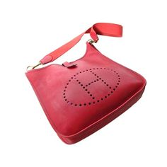 Hermes red leather Evelyn handbag with pierced H logo - $2000.
