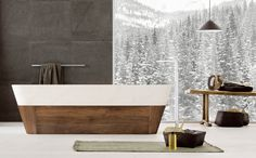 DUO BATHTUB in natural stone with wooden base. #madeinitaly, #stone, #naturalstone, #interior, #architecturedesign, #interiordesign, #forniture,  #bathroom, #bathtub,  #hydrobathtub, #Bathroomcollection, #wood,
