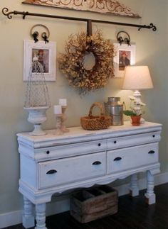 Hang a wreath or even pictures on a curtain rod. I love this look. Very inviting and cozy! by lupe