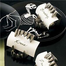Vampire Teeth Place Card holders are fun and a little scary, like that chick you met at that goth club. Because like her, they share the sentiment that a party's just not a party unless someone get...