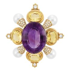 Gold, Amethyst, Citrine, Diamond and Cultured Pearl Clip-Brooch  18 kt., centering one oval amethyst approximately 48.00 cts., quartered by 4 collet-set oval citrines tipped by round diamonds, spaced by 4 pearls approximately 9.8 mm., joined by diamond-set caps, totaling 76 round diamonds approximately 1.70 cts., approximately 30.4 dwts.