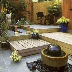 Make the most of a Small Yard -- Tiered Backyard - Step Up and Out Create levels in a small yard to define spaces, making these areas seem like multiple outdoor rooms. Mix materials like decking (shipping pallets), stonework, & even grass to give each space its own special feel.