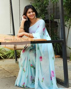 PV 3942 : Blue Bird Price : 3200 Rs Look like a dream girl in this beautiful sky blue chiffon sari with floral print Unstitched blouse piece : Pink blouse piece For Order Trendy Dresses, Elegant Dresses, Chiffon Saree, Organza Saree, Georgette Sarees, Lehenga Blouse, Silk Sarees, Saree Blouse Neck Designs, Blouse Designs