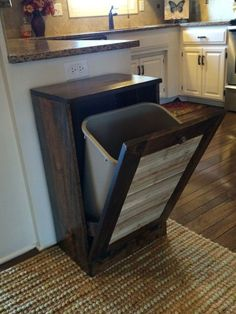 Tilt out trash can holder made from pallet wood
