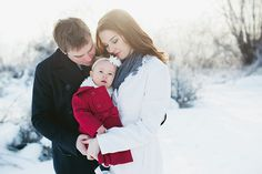 """I personally love white on white in winter. I think this image would have been even more powerful if dad were in white also and the little girl the """"pop"""" of color with the red!"""
