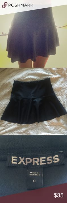 NWOT Faux Leather Mini Skirt This is a black faux leather mini skirt from express.  It no longer has the tags, but I have never worn it.  It fits close to the body at the waist and then flows out at a drop waist - super cute!  Perfect for a night out or a chic outfit this fall! Express Skirts Mini