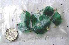 Vintage Green Glass Detailed Leaf Beads - Lot of 7 http://www.ebay.com/itm/181249101352?ssPageName=STRK:MESELX:IT&_trksid=p3984.m1555.l2649