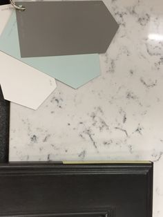 Lyra Quartz countertop and Dovetail grey from Shewwin Williams along with white and aqua. The colors of my kitchen, and all available through Lowes.