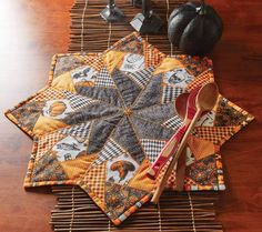 Holiday quilt patterns make great centerpieces! This star-shaped table topper called Crazy for Halloween, designed by Jean Nolte using fabrics by Patrick Lose, has a spooky motif and is made to impress. Get the quilt kit while supplies last.
