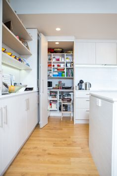"""Kitchen 516 by Sally Steer Design for Progressive Homes, Wellington New Zealand. Walk-in pantry with bifold door. 20mm Caesarstone """"Nougat"""" benchtops with negative detail."""