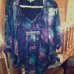 REDUCED!!!   Multicolored top V neck with silver design. Black  cami is attached and the sleeves batwing style Jennifer Lopez  Tops