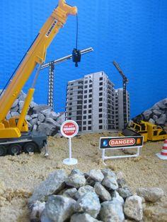 Arrange diggers on sand