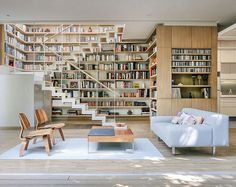 Woah these homeowners might like books...  This project in #MexicoCity by @paulcremouxstudio took an existing #home and reworked it into a smaller, more #sustainable one with better use of space and indoor/outdoor living. Photo by PCW.