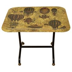 A Piero Fornasetti Air Balloon Decorated Small Folding Table.