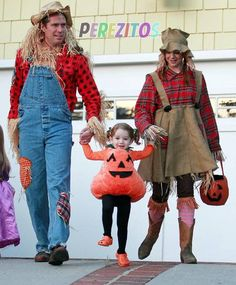 Alyson Hannigan and Alexis Denisof, third Halloween as a family.... they're Scarecrows and daughter Satyana is the pumpkin!