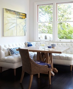 Cool blue and white palette! Banquette covered in faux-ostrich vinyl from Kravet.