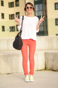 coral pants, white shirt, & love the yellow sneakers!