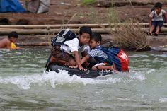Clinging on for dear life: These two brave young boys have to use a tyre as a makeshift raft to get to school along a river in Rizal Province in the Philippines Schools Around The World, Kids Around The World, We Are The World, Around The Worlds, Philippines, Values Education, Walk To School, Take Shelter, School Photos