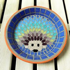 The Design A mosaic water dish which is slightly smaller than the bird bath version. It has a hedgehog design using shades of purples, blues, turquoises and jade greens. This dish is perfect to use as a water dish to leave fresh water out for the hedge. Sleeping Pods, A Hedgehog, Nesting Boxes, Shades Of Purple, Unique Gifts, Mosaic, Decorative Plates, Wildlife, Bee
