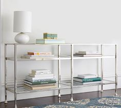 When creating vignettes, be sure to create groupings. The repetition of horizontally stacked books on this metal console is pleasing to the eye and allows for multiple styling options.